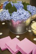 Hydrangea flowers on table with party food Stock Photos