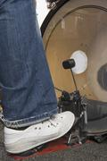 Close-up of drummer's foot and bass drum - stock photo