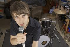 Singer of band practicing in studio Stock Photos