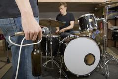 Rock band practicing and drinking beer Stock Photos