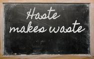 Stock Illustration of expression -  haste makes waste - written on a school blackboard with chalk