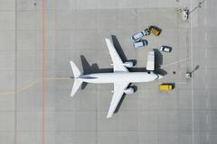 Aerial view of airplane and vans Stock Photos