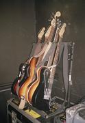 Electric guitars arranged on rack Stock Photos