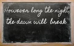 expression -  however long the night, the dawn will  break - written on a sch - stock photo