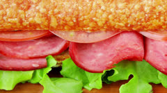 sandwich with smoked sausage - stock footage