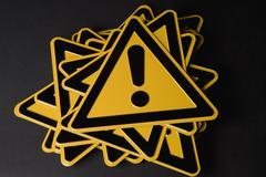 Hazard' warning sign on top of stack Stock Photos