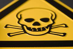 Toxic substance sign with skull and crossbones - stock photo