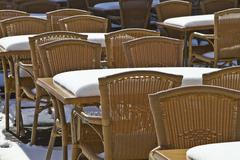 chairs in the summer cafe, covered with snow. - stock photo