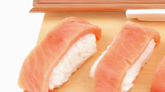 Nigiri sushi topped with raw Salmon . Isolated over white backgr Stock Footage