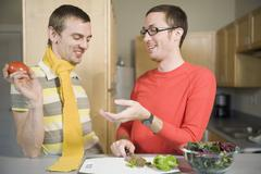 Stock Photo of Two men preparing food in kitchen