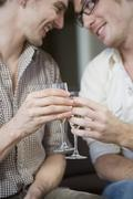 Gay couple toasting with champagne Stock Photos