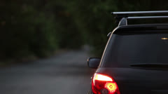 SUV with hazard lights near the road Stock Footage