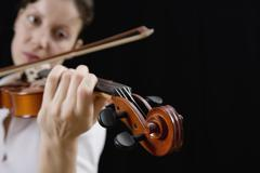 Woman playing a violin - stock photo
