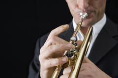 Man playing a trumpet - stock photo