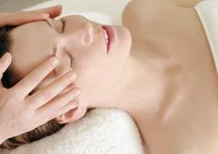 Stock Photo of Woman receiving a massage at a beauty spa