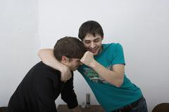 Young men play fighting Stock Photos