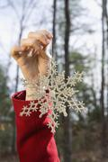 Young woman holding a decorative snowflake Stock Photos