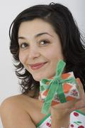 Stock Photo of Woman holding present