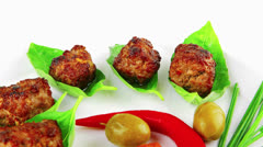 Grilled cutlets on basil leafs Stock Footage