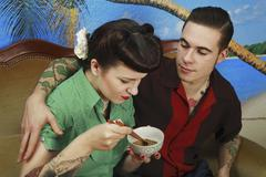 Young rockabilly couple sitting together Kuvituskuvat