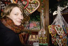 Woman standing at a market stall with heart-shaped gingerbread cookies, Berlin, Stock Photos