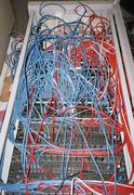 Cables connected to computer network server Stock Photos