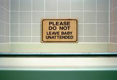 Warning sign above bathtub Stock Photos