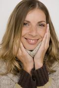 Portrait of a woman wearing turtleneck sweater - stock photo