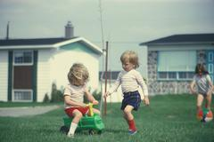 Stock Photo of Children playing in their front yard