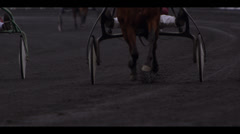 HARNESS RACING - HORSES APPROACHING Stock Footage