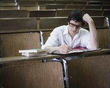University student taking notes in a lecture theatre Stock Photos