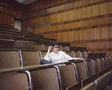 University student sitting in an empty lecture hall Stock Photos
