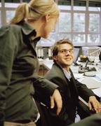Stock Photo of Office colleagues gathered at a desk