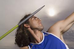 Man throwing a javelin Stock Photos