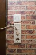 Electric plug and socket on a wall Stock Photos