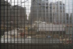 View through metal grid of construction site Stock Photos