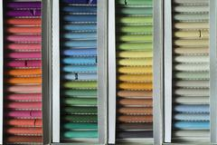 Rows of multi-colored chalk Stock Photos