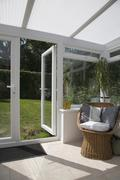 Conservatory with an open door leading to the backyard Stock Photos