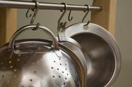 Kitchen utensils hanging in a row Stock Photos