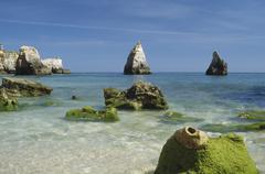 Rock formations along the coastline, Lagos, Algarve, Portugal Stock Photos