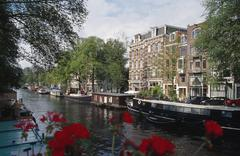 View of buildings and boats from Magere Brug, Amsterdam, Netherlands Stock Photos