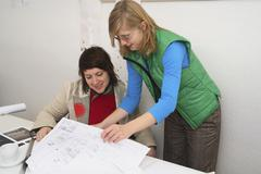 Architects looking at drawings - stock photo
