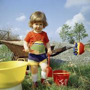 Girl playing in garden Stock Photos