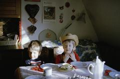 Two boys sitting at the dining table Stock Photos