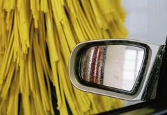 Side view mirror of a car in a car wash Stock Photos