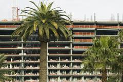 Palm trees in front of high rise building development, Las Vegas, Nevada Stock Photos