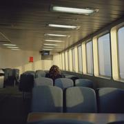 Rear view of a woman sitting on a ferry Stock Photos