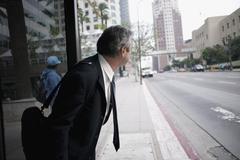 Businessman waiting for a bus Stock Photos