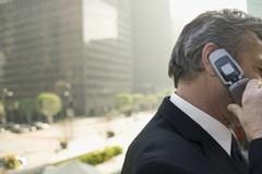A businessman using a mobile phone - stock photo