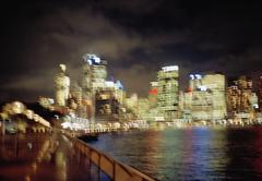 Blurred night view of Sydney skyline Stock Photos